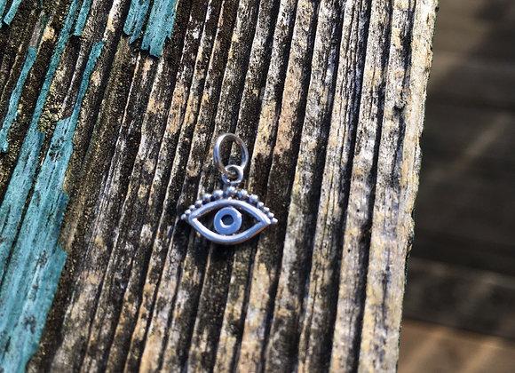 Tiny evil eye charm