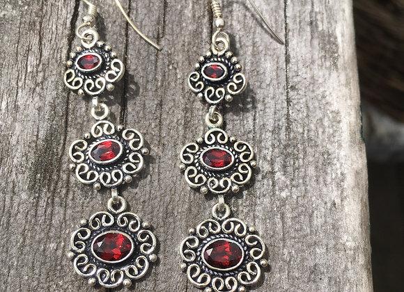 Long garnet three stone earrings