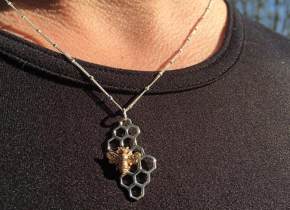 Long honeycomb with bronze bee pendant