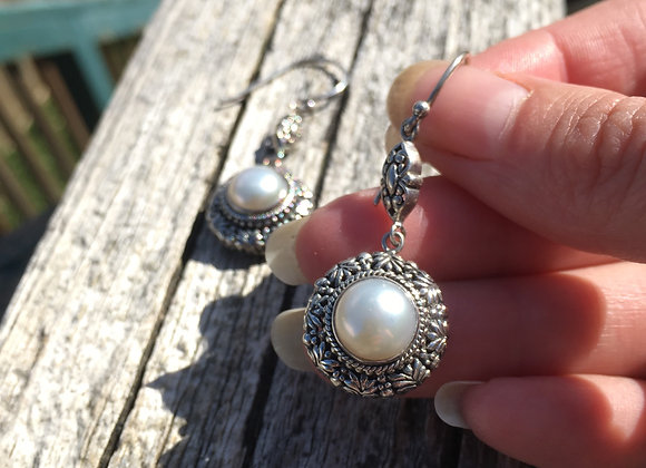 White pearls in ornate setting