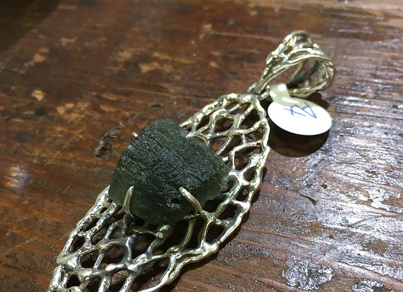 Large raw Moldavite in cutout silver