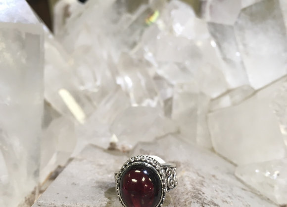 Chunky detailed silver work garnet ring