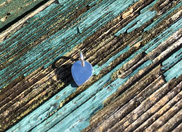 Tiny silver petal pendant