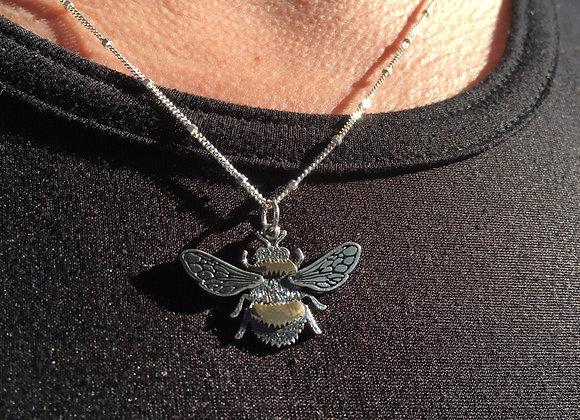 Detailed silver and bronze honeybee pendant