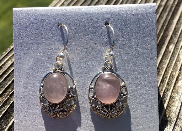 Detailed setting rose quartz earrings