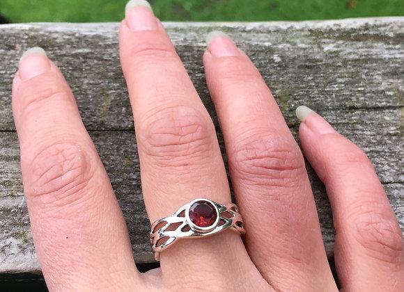 Round garnet Celtic ring