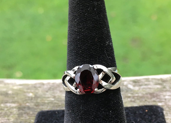Claw set garnet Celtic ring