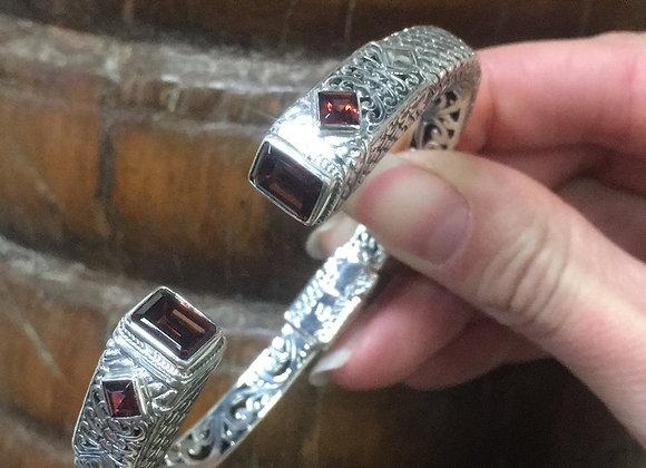 Garnet hinged silver bracelet