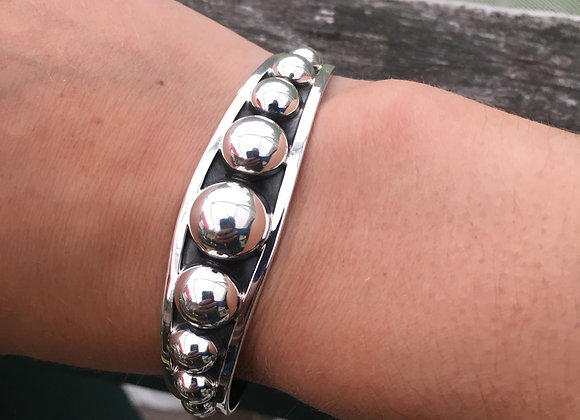Tapered studded cuff