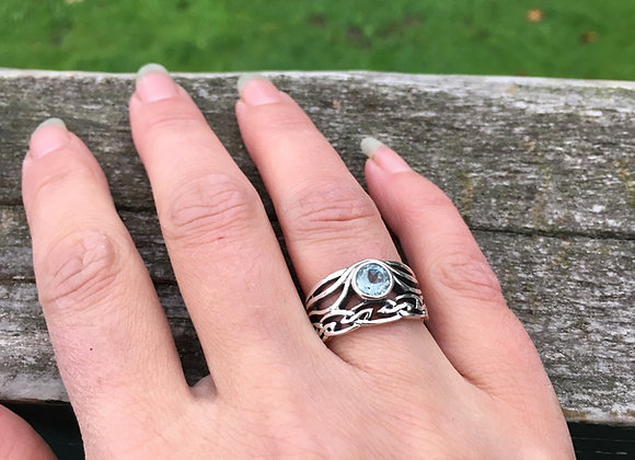 Blue topaz double Celtic band ring
