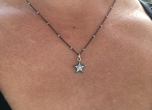 Cubic zirconia oxidized star pendant