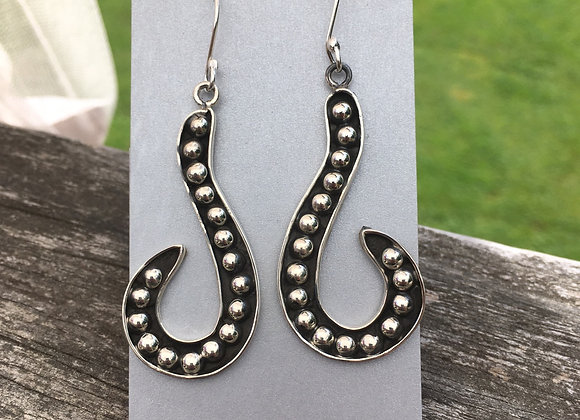 Curved studded dangle earrings