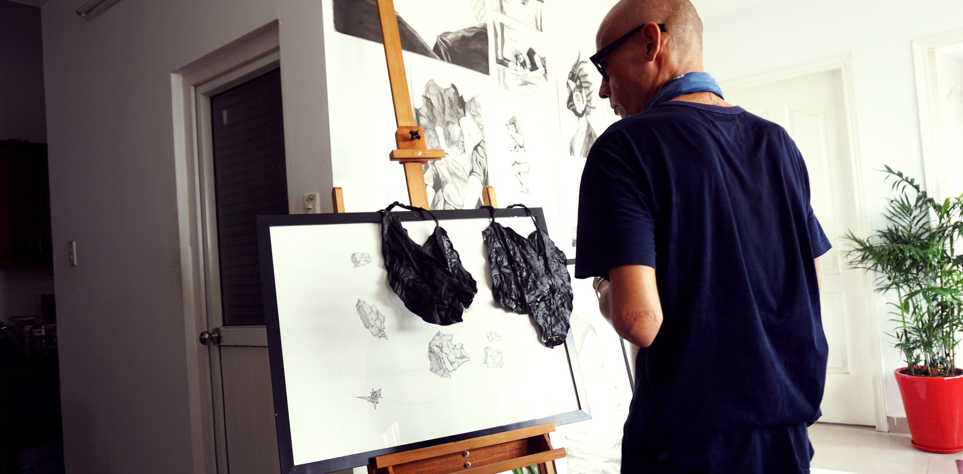 Examining the work in progress of a new series of artwork.  Photo by: Linh Phan