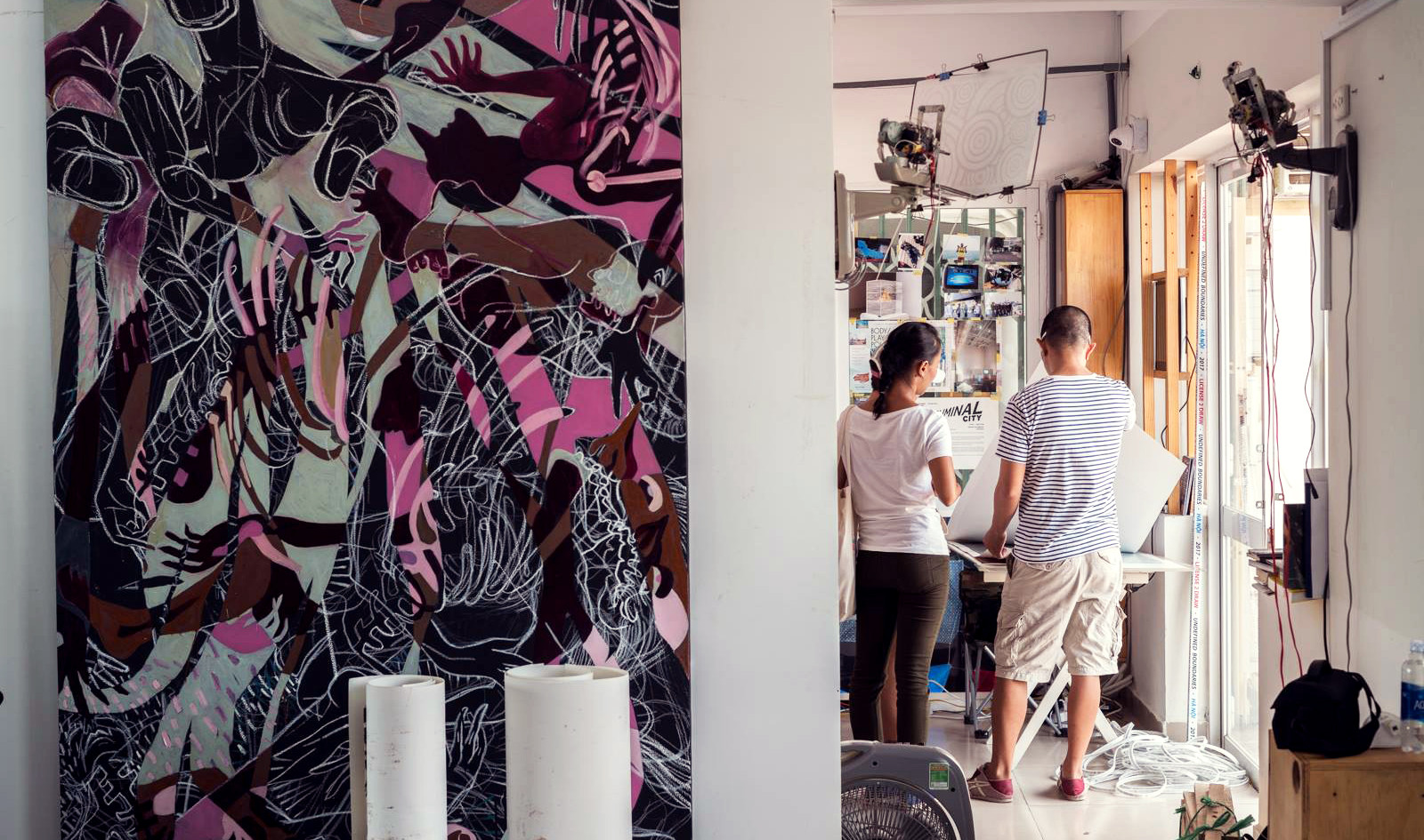 Guests exploring a shared studio space of 4 local artists.   Photo by: Dave Lemke