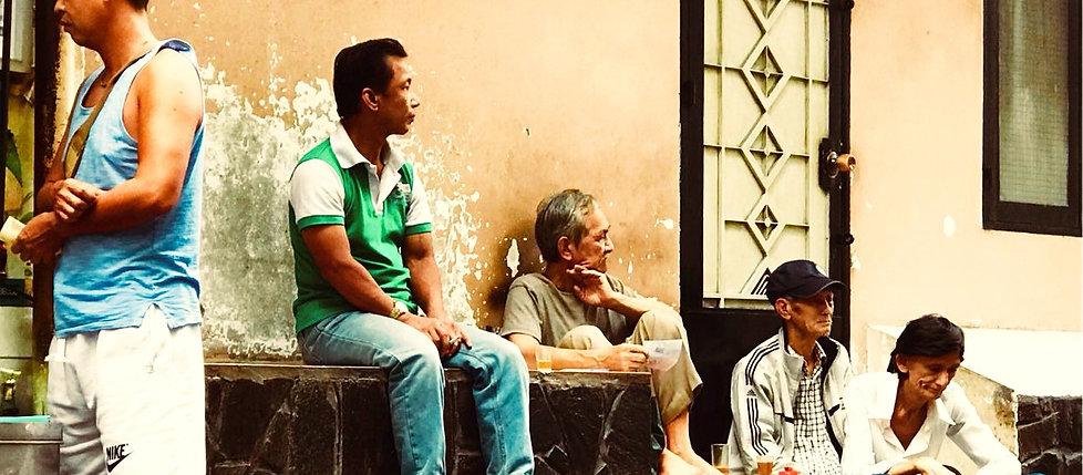 Men Sitting on Wall_edited.jpg