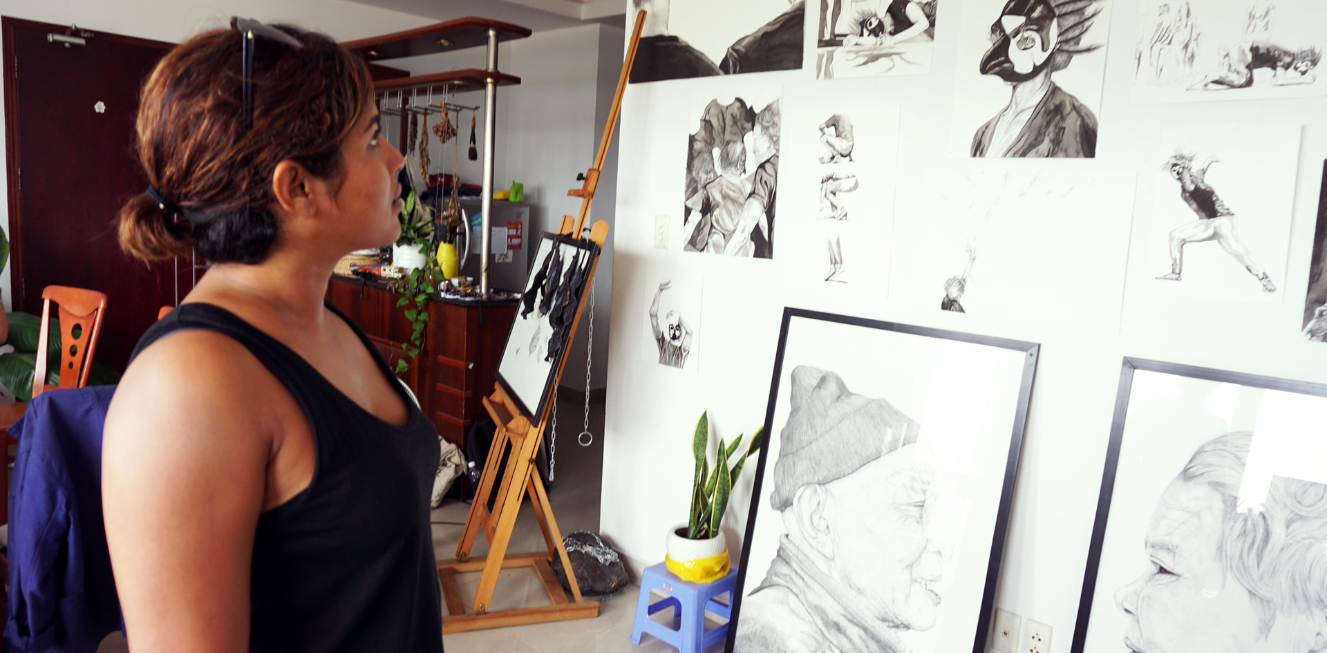 Guests exploring the intricate hand drawn art work.  Photo by: Linh Phan