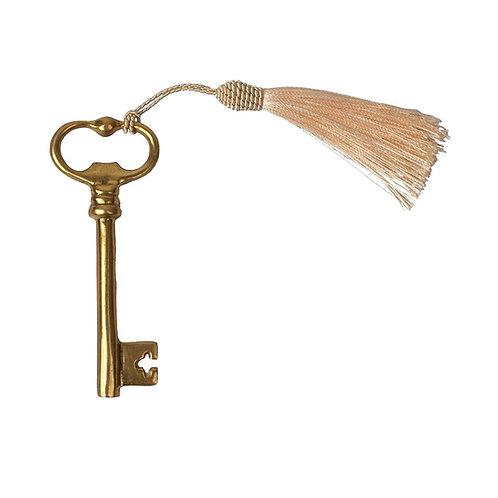 Bottle opener key + tassle