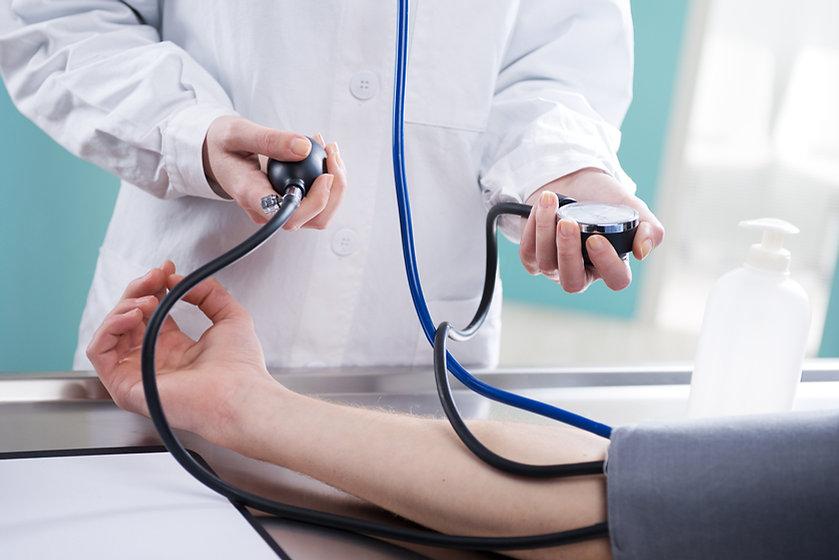 Taking blood pressue