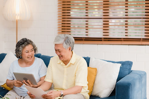 asian-elderly-couple-using-tablet-watchi