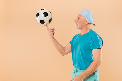 modern-senior-man-with-football.jpg