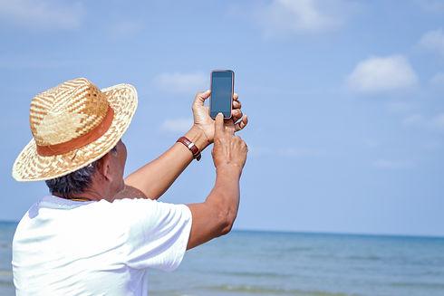 elderly-asian-man-holding-phone-take-pic