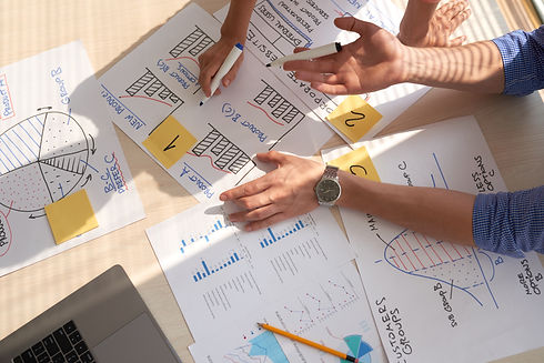 top-view-creative-team-discussing-busine