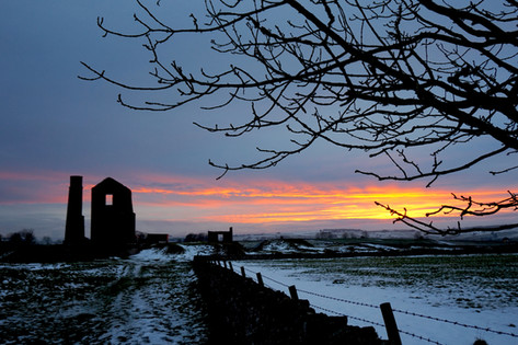Sunset over snowy Magpie Mine