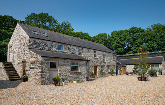 A ciurtyard of 4 cottages sleeping upto 22 people