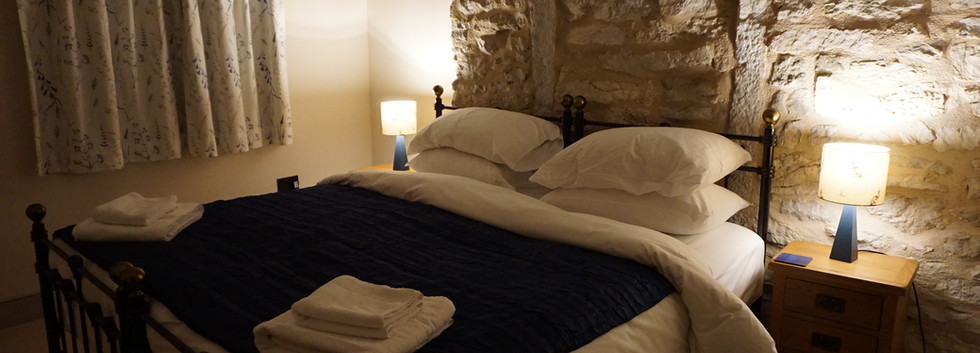 Cosy night with feature stonework and original beams.