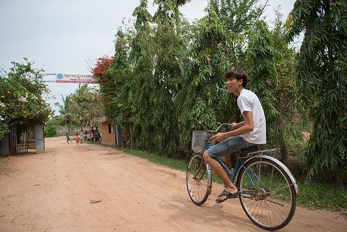 boy on bike in front of Rescue.jpg