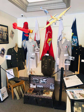 """The centerpeice of this display is trunk from the Family of Wayne Hardin. The trunk was sent home after his death in 1945 and remained basically """"as was"""" still is today. May need more space for this one!"""