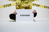 person-holding-covid-sign-3951600.jpg