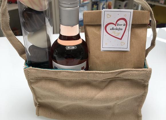 Handtasje met wijn, snoep en pralines