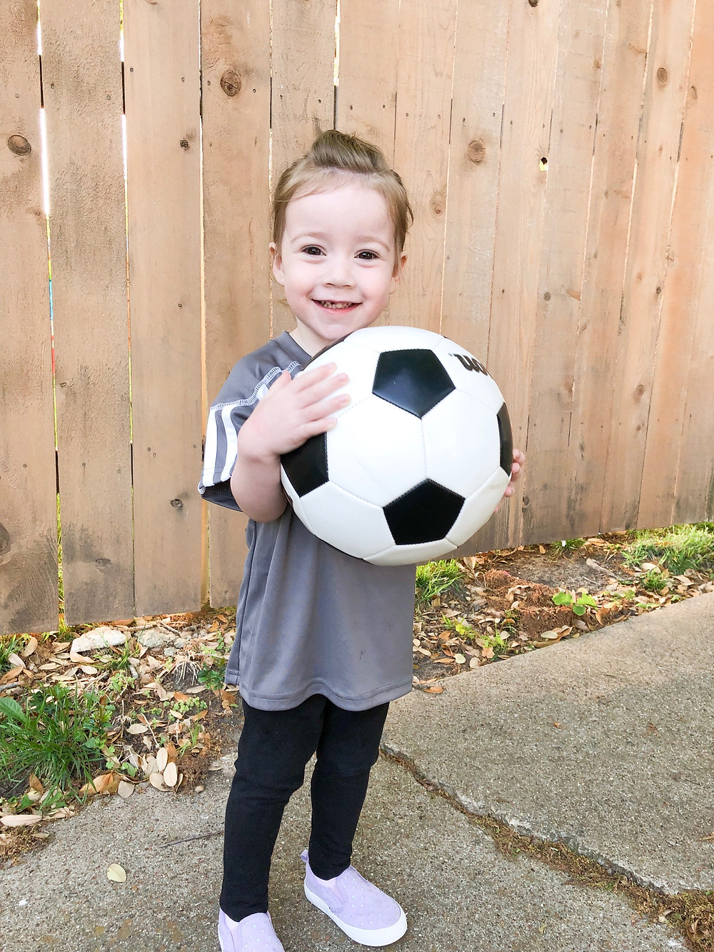 Lucy holding a soccer ball