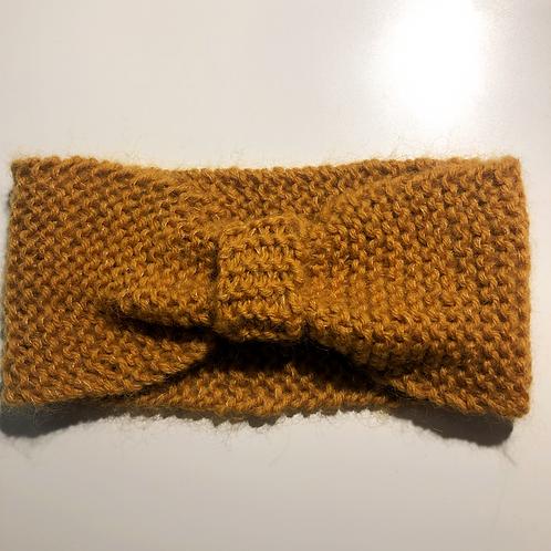 Pannebånd med knute.
