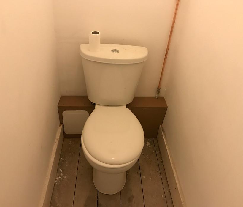 Toilet rear boxing in