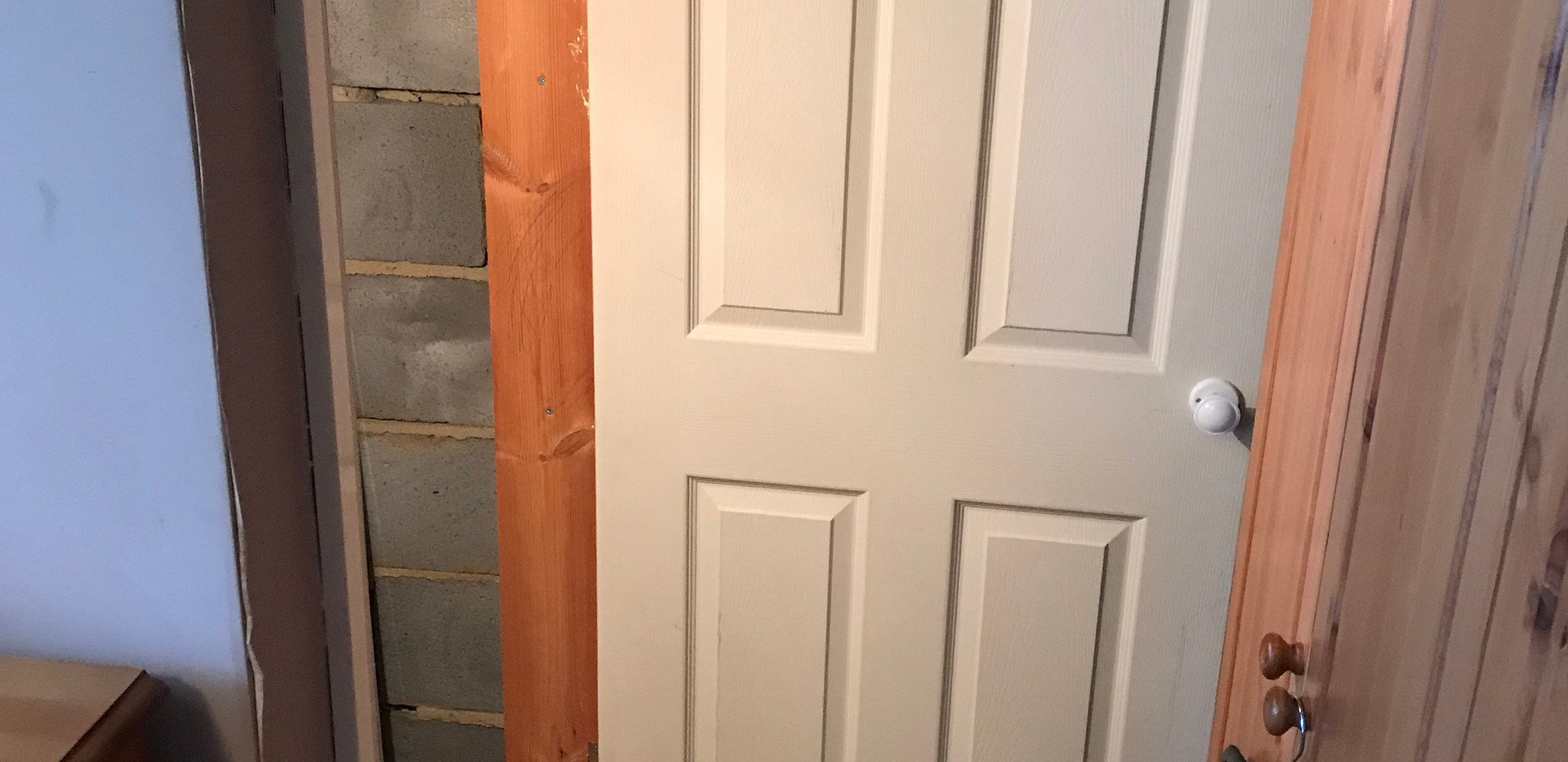 Eaves cupboard storage door