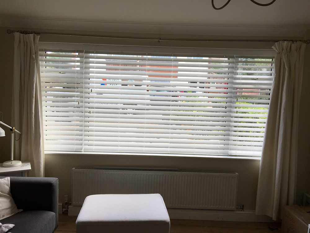 A 12 foot window fitted with 63mm faux wood bishop storford