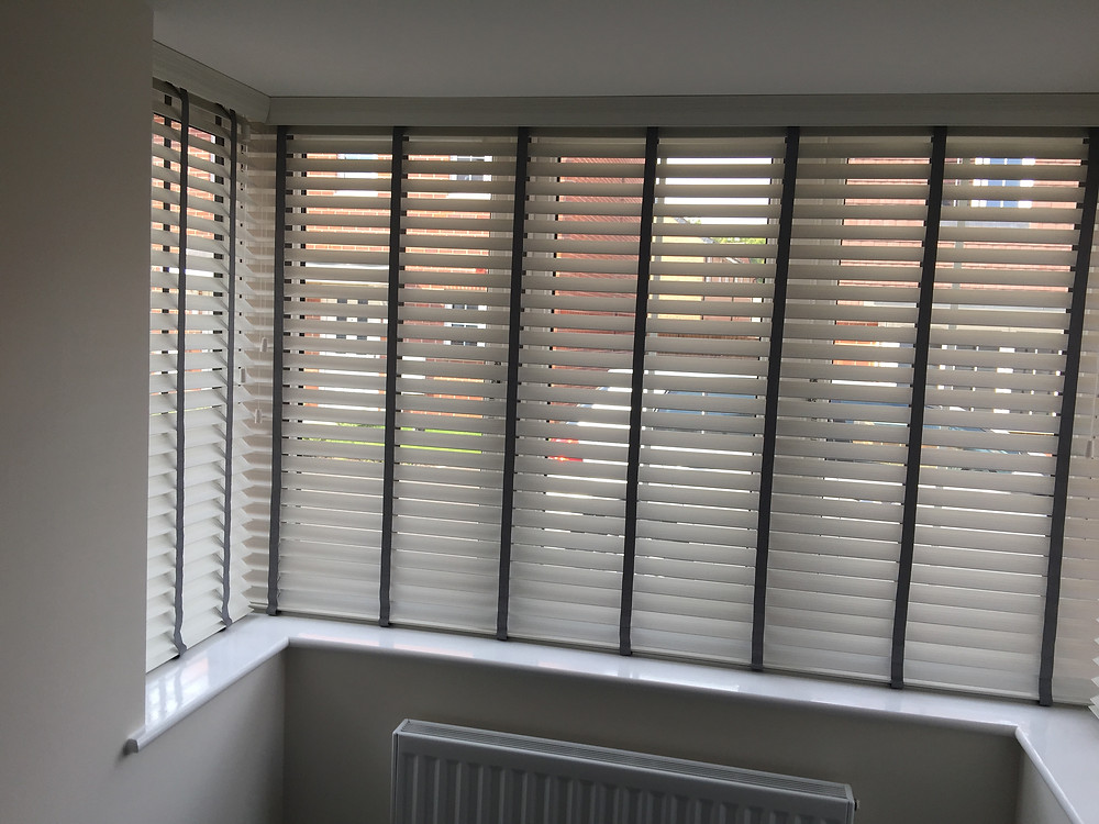 wood blind with grey tape