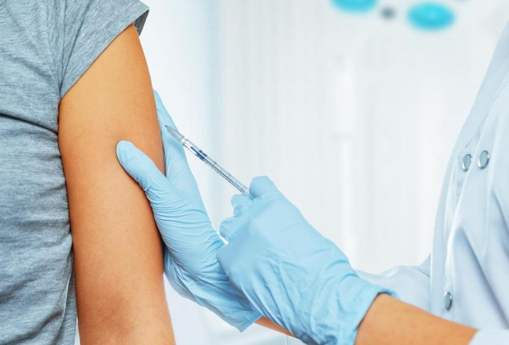 person-injecting-needle-into-another-persons-arm.jpg