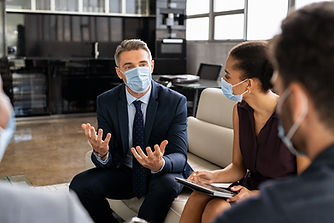 business-people-talking-in-meeting-with-face-mask-34G4GQT.jpg