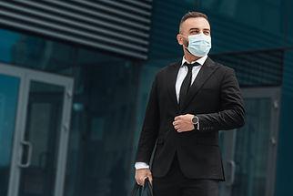 business-life-mature-businessman-adjusting-suit-bu-JRGEKQU.jpg