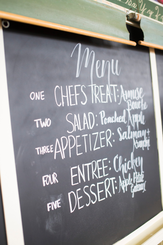 5 course menu for Pop-Up Dinner written on the school's half board.