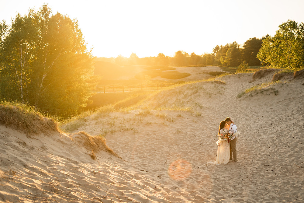 couple at their destination wedding in Wisconsin. Kohler Andrae State Park