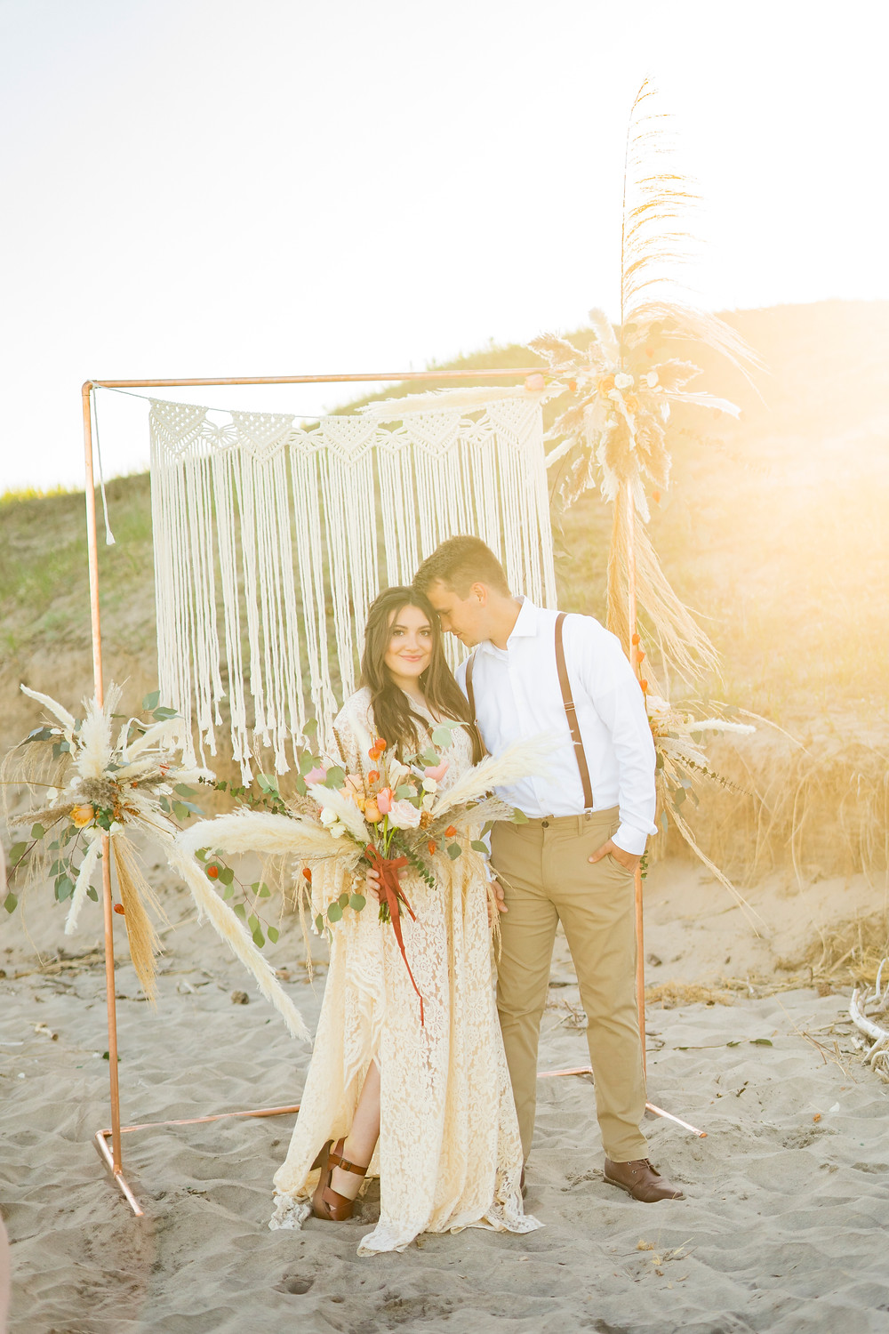 Macrame on copper arch on beach for an elopement