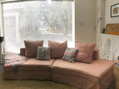 Sofa curvo desenfundable en Lino
