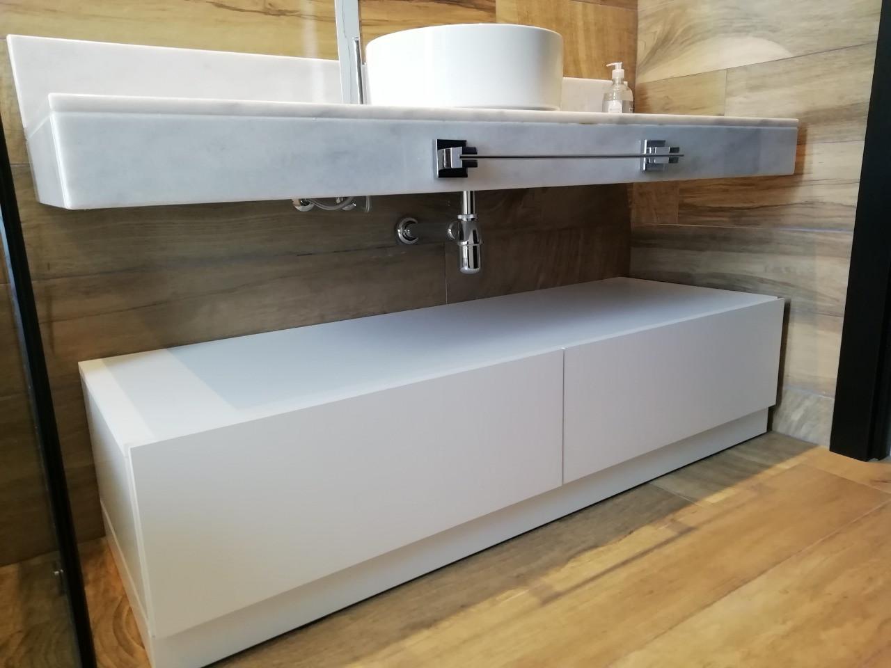 Mueble sobre piso para guaradado en cajones en melamina blanca