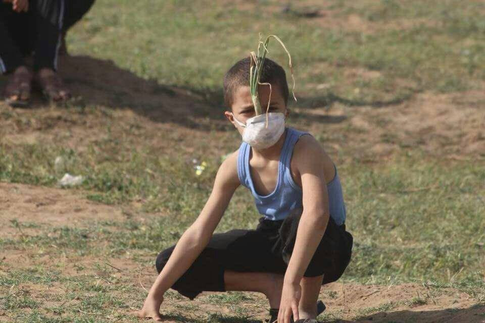 This image is used as fair dealing under Australian copyright law. It is relevant to the topic of the blog and honestly it struck me when I came across it. A Palestinian boy wearing a mask with an onion inside it to protect himself against gas bombs  thrown by Israeli occupation forces at the Gaza border