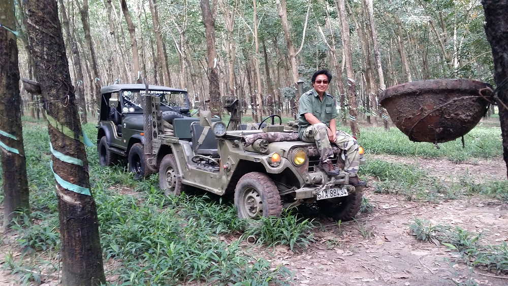 Vinh Tran in Vietnam with one of his jeeps.