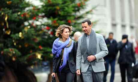 This image is claimed as fair dealing under Australian copyright law. Bashar al-Assad and his wife Asma in Paris in 2010. Asma al-Assad was until recently seen as an international style icon. Photograph: Miguel Medina/AFP/Getty Images